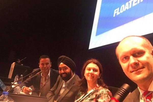 Das Panel: Dr. Erik Mertens (BE), Dr. Paul Singh (US), Roxana Fulga und Dr. Andrzej Dmitriew (PO).